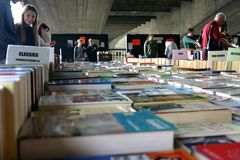 A Book thrift shop under a bridge. Royalty Free Stock Photos