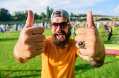 Book ticket now summer festival. Highly recommend top list events. Hipster visiting event picnic fest or festival. Man. Cheerful face shows thumb up. Man stock images