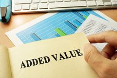 Book with title added value. Book with title added value in an office royalty free stock photo