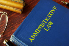 Book with title administrative law. On a table Stock Photos