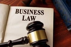 Book with title business law on a table. Book with title business law and gavel on a table royalty free stock photo