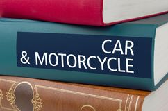 A book with the title Car and Motorcycle written on the spine royalty free stock photo