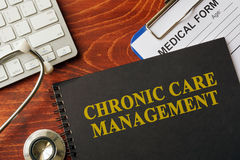 Book with title chronic care management on a table. Royalty Free Stock Photo