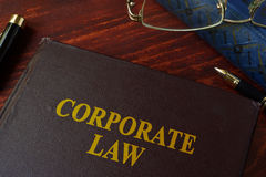 Book with title corporate law. On a table Royalty Free Stock Photo