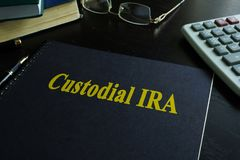 Book with title Custodial IRA. Book with title Custodial IRA on a desk Stock Photography