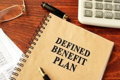 Book with title Defined Benefit Plan. Book with title Defined Benefit Plan on a desk Royalty Free Stock Photos