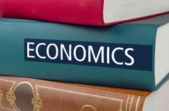 Book with the title Economics written on the spine. A book with the title Economics written on the spine royalty free stock image
