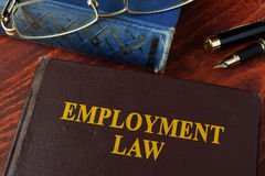 Book with title employment law. On a table Stock Photos