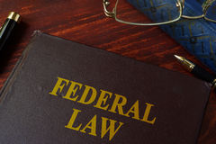 Book with title federal law. Book with title federal law on a table Royalty Free Stock Photo