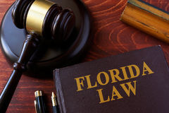 Book with title Florida law. Book with title Florida law and a gavel stock image