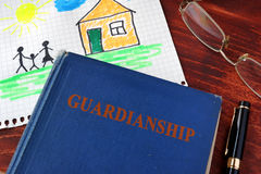 Book with title Guardianships and children's picture. Royalty Free Stock Image