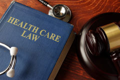 Book with title Health Care Law. On a table Stock Photography