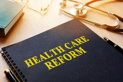 Book with title health care reform. Book with title health care reform on a desk Royalty Free Stock Photography