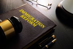 Book with title Immigration reform. royalty free stock photography
