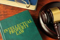 Book with title intellectual property law. Book with title intellectual property law on a table Royalty Free Stock Image