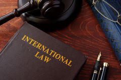 Book with title International law. Book with title International law and a gavel Royalty Free Stock Images