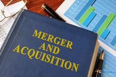 Book with title Merger and Acquisition. Book with title Merger and Acquisition on a table Royalty Free Stock Photos