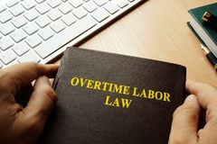 Overtime labor law. Book with title overtime labor law stock images