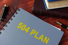Book with title 504 plan. Royalty Free Stock Photos