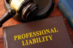 Book with title professional liability. Book with title professional liability and gavel on a table stock images
