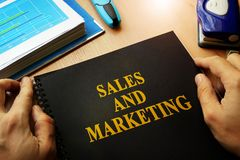 Sales and marketing. Book with title sales and marketing Royalty Free Stock Images