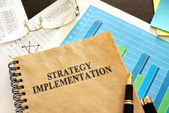 Book with title strategy implementation. Book with title strategy implementation and financial data Stock Image