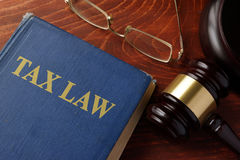 Book with title tax law. Book with title tax law on a table Stock Photo