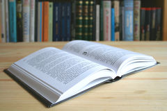 Book to read. Book on the table near the bookcase royalty free stock photos
