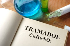 Book with tramadol  and test tubes. Royalty Free Stock Images
