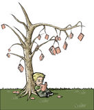 Book tree. Boy sitting under a book tree Stock Photo