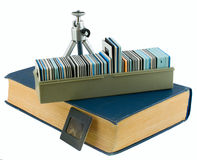 Book, tripod, box, slides Royalty Free Stock Photography