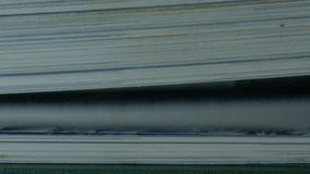 Book with turning pages. Extreme close-up of a book pages in turning action stock video