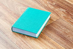 The book turquoise colour in a firm cover. Royalty Free Stock Photo