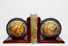 A book and two globe. Religious book of the seven hundred between two globe Stock Photo