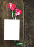 Book with two hearts laying on old boards Royalty Free Stock Images