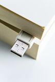 Book with USB plug Royalty Free Stock Photos