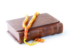 Book in a vintage leather bound, and beads Stock Images