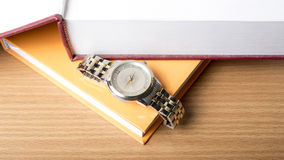 Book with watch Stock Photography