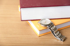Book with watch Royalty Free Stock Photography