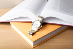 Book with watch Stock Image