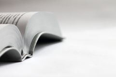 Book on a white background. Bible. Open book on a white background. Soft images. The Bible in Russian Stock Photography