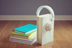 Book with white headphones Royalty Free Stock Photography
