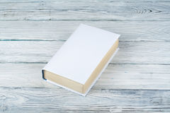 Book on a white wooden table. Education business concept. Book on a white wooden table royalty free illustration
