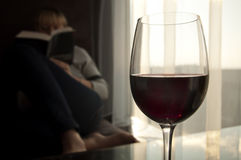 Book and wine - relaxing at sunset Royalty Free Stock Images