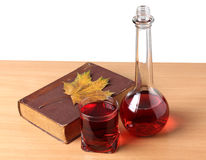 Book and wineglasse Stock Photos