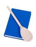 Book wit wooden spoon. Stock Photography