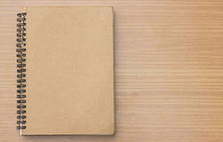 Book on wood background. Royalty Free Stock Photo