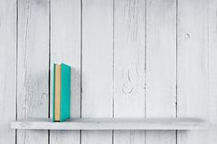 Book on a wooden shelf. Royalty Free Stock Photography