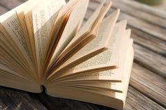 Book on a wooden table Stock Photos