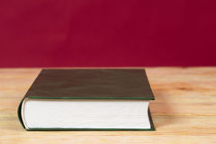 Book on wooden table. Back to school. Copy space.  Royalty Free Stock Photos
